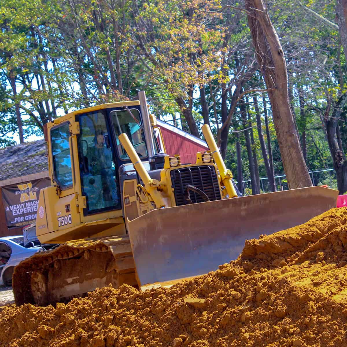 Bulldozer plows dirt