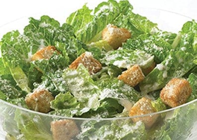 Lettuce and croutons with Caesar dressing in a bowl
