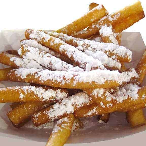 Funnel cake sticks in basket covered in powdered sugar