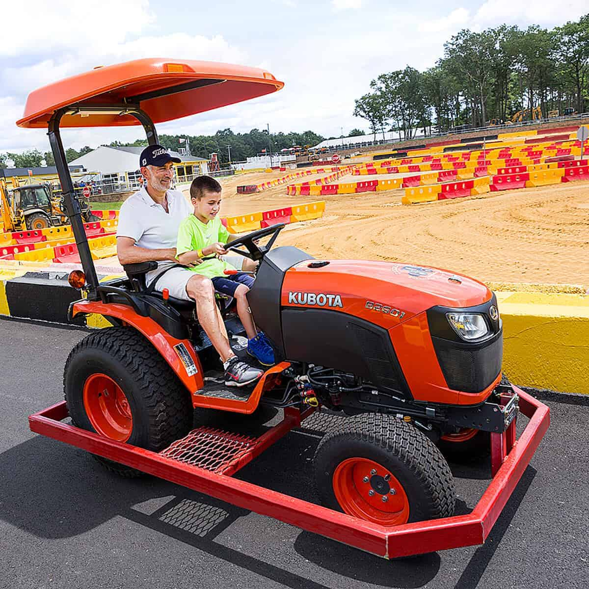 Kubota tractor ride with grandfather and grandson