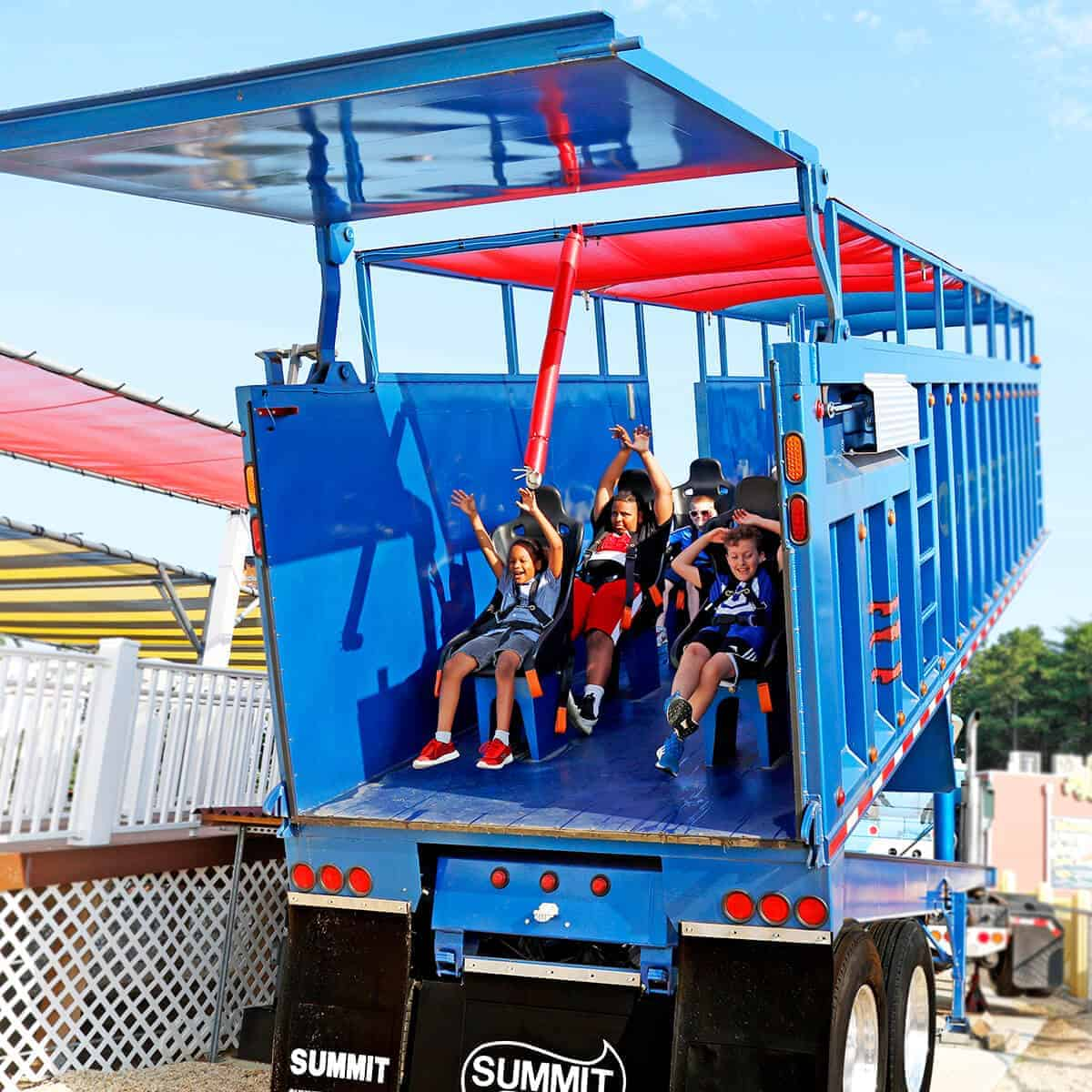 Cheering kids being lifted from the Greased Beast
