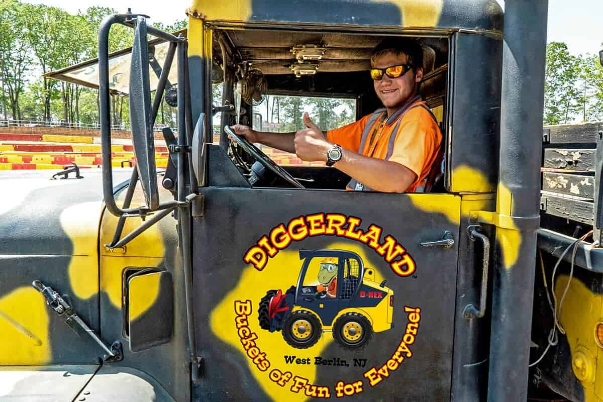 Diggerland ride operator giving a thumbs up to the camera