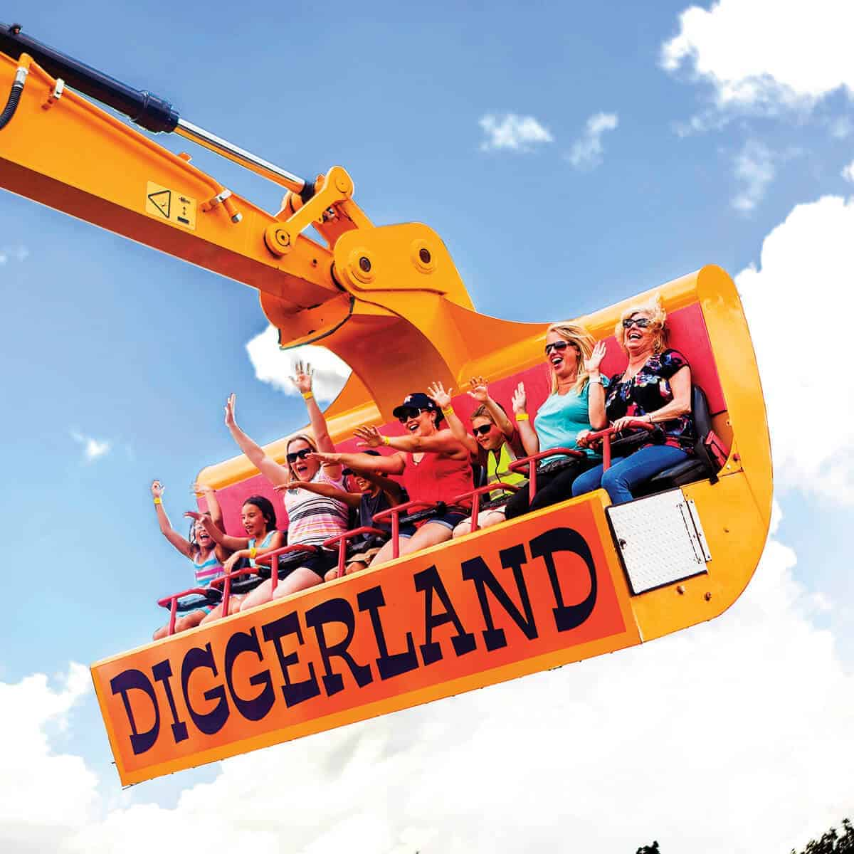 Family on the Spin Dizzy excavator ride at Diggerland USA