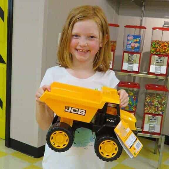 Girl with 14 inch JCB dump truck