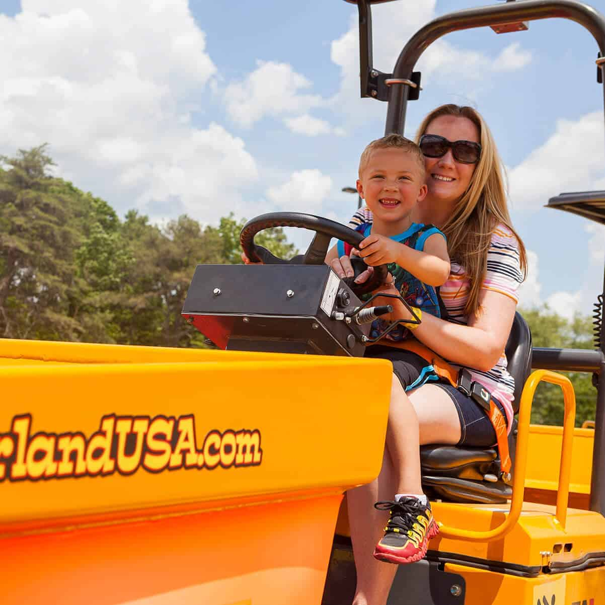 Woman and son behind the wheel of the Dumper Truck