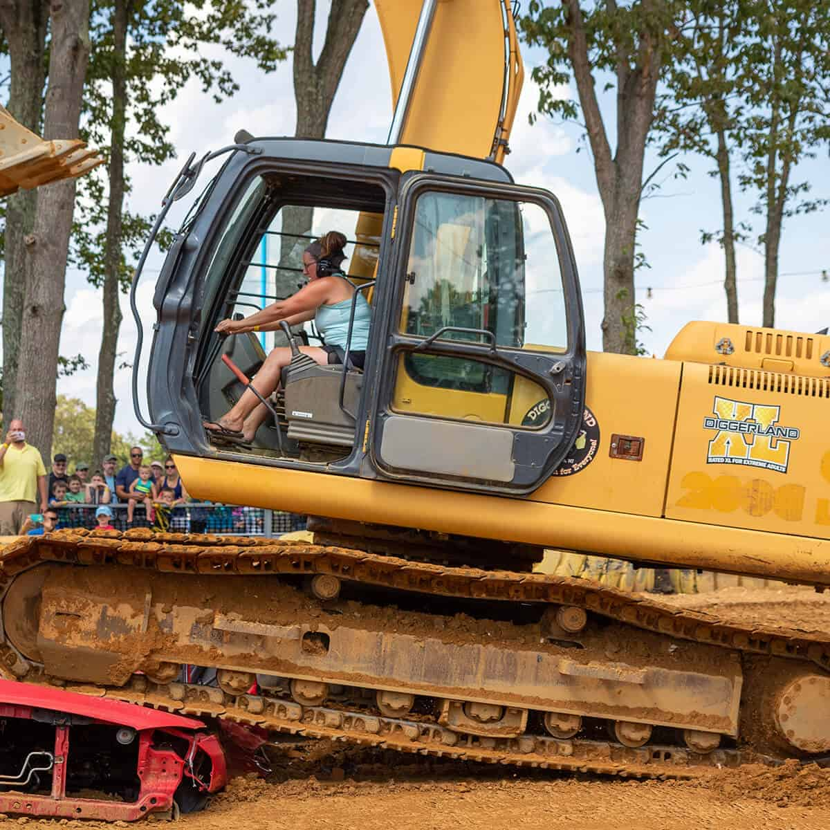 XL experience with a woman crushing a car on a real excavator